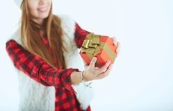 Time to open presents. winter portrait of a beautiful young smiling woman with a gift in her hands Stock Photography