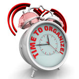 Time to organize! The alarm clock with an inscription Stock Photography
