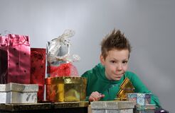 Boy wrapping up christmas gifts