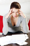 Time to pay. A young beautiful woman stressed because of bills stock photos