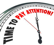 Time to Pay Attention Words Clock Listen Hear Information. Time to Pay Attention words on a 3d clock face to illustrate importance of listening and hearing vital Royalty Free Stock Image
