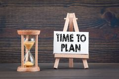 Time To Plan. Sandglass, hourglass or egg timer on wooden table Royalty Free Stock Images