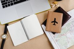 Time to plan travel concept, stylish notebook map watch and pass Stock Photography