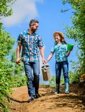 It is time to plant prepare beds and care for lawn. Pick out flats favorite plants. Gardening pro tips. Spring gardening. Father and daughter with shovel and royalty free stock photo