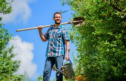 It is time to plant prepare beds and care for lawn. Pick out flats favorite plants. Gardening pro tips. Spring gardening. Man bearded hipster hold shovel and royalty free stock photo