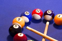 Time to play pool (billiards). Clock dial made of billiard balls and que-sticks stock image