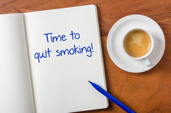 Time to quit smoking. Notebook on a desk - Time to quit smoking Stock Photo
