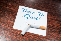 Time To Quit Smoking Reminder With Broken Cigarette On Wooden Shelf Royalty Free Stock Image