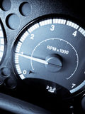 Time to Race. Blue filtered image of car RPM Gauge revving at 1000 RPM Royalty Free Stock Photo