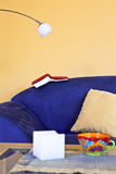 Time to read. A reading corner with a blue couch, a book and a reading lamp Stock Photography