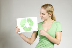 Time to recycle!. Young woman holding recycling symbol Stock Photo