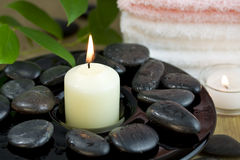 Time to relax. Pebbles towel and candle. Time to relax royalty free stock photography