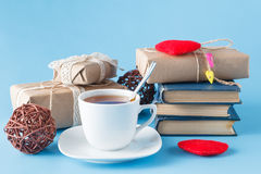 Time to relax with cup of tea and books - tea time Royalty Free Stock Photos