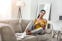 Pretty young female person having rest at home royalty free stock photos