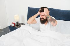 Time to relax. energy and tiredness. mature male with beard in pajama relax in bed. bearded man hipster sleep in morning. Asleep and awake. brutal sleepy man royalty free stock photo
