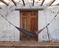 Time to relax – hammock at the old terrace in front of antique wooden door Royalty Free Stock Photography