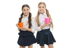 Time to relax. Schoolgirls with mugs having tea break. Relax and recharge. Water balance concept. Enjoying tea together royalty free stock images