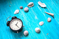 Time to relax, watch, seashells, blue wood background, concept h Stock Photos