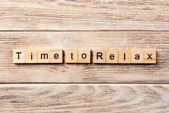 Time to relax word written on wood block. time to relax text on table, concept.  stock photos