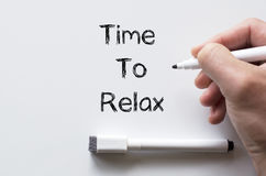 Time to relax written on whiteboard Royalty Free Stock Image