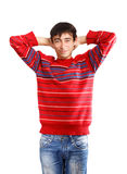 Time to relax. Young man in red sweater standing on white background Royalty Free Stock Photography