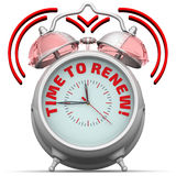 Time to renew! The alarm clock with an inscription Royalty Free Stock Photography