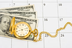 Time to retire. A gold pocket watch with cash on a white calendar background, Time to retire Royalty Free Stock Images