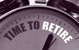 Time to retire clock face. Classic Alarm clock with the phrase Time to Retire on a great concept for retirement planning and provision Stock Photography