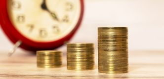 Time to savings - money coins with alarm clock Royalty Free Stock Image