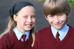 Time to school. Brother and sister are going to irish school this morning in uniforms Stock Photo