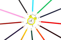 Time to school. Watch and crayons as concept for school time Royalty Free Stock Image