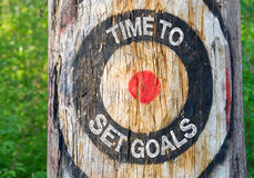Time to set Goals. Tree in the forest with target and text royalty free stock photos
