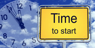 Time To Start Sign And Clock Stock Photos