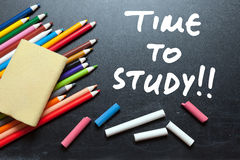 Time to study. School tools around. Blackboard background Royalty Free Stock Image