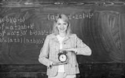 Time to study. Welcome teacher school year. Experienced educator start lesson. What time is it. She cares about stock photos