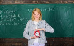 Time to study. Welcome teacher school year. Experienced educator start lesson. What time is it. She cares about stock photo