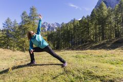 Exercising in nature. Time to take care of yourself. Exercising in nature. Outdoor activities in the fresh air stock image