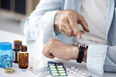 Time to take pills for old man. Time to take pills  for old man Stock Photos