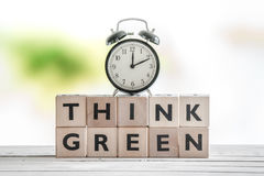 Time to think green sign. On a wooden table Royalty Free Stock Images