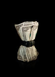 Time to tighten your belt. Dollar bills squeezed by belt symbolising a tight economy Royalty Free Stock Image