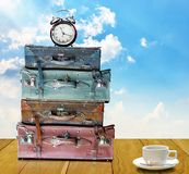Time to travel concept. Travel bags with alarm clock Stock Images