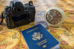 Time to travel. Travel time concept with camera, passport and clock stock images