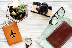 Time to travel concept, flat lay. map passport money compass and. Glasses photo camera on white wooden background top view. planning vacation. space for text Royalty Free Stock Images