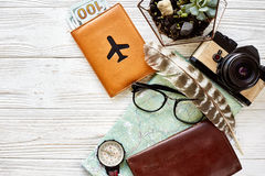 Time to travel concept, flat lay. map passport money compass and. Glasses photo camera on white wooden background top view. planning vacation. space for text Royalty Free Stock Photos