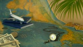 Time to travel concept. Tropical vacation theme with world map, blue passport and plane. Preparing for holliday, journey. Trip items with copy space. North stock video