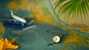 Time to travel concept. Tropical vacation theme with world map, blue passport and plane. Preparing for holliday, journey. Trip items with copy space. North stock footage