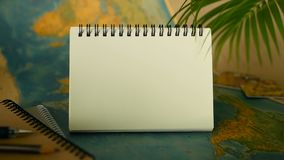 Time to travel concept. Tropical vacation theme with world map and notebook. Trip items with copy space stock video footage