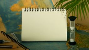 Time to travel concept. Tropical vacation theme with world map and notebook. Trip items with copy space stock footage