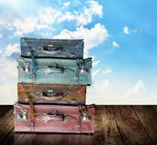 Time to travel concept. Vintage travel bag on wooden table Stock Photos