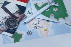 Time to Travel. Idea for tourism with an airplane, passport and tickets, compass and map on a light background. Concept. On the theme of flights royalty free stock images